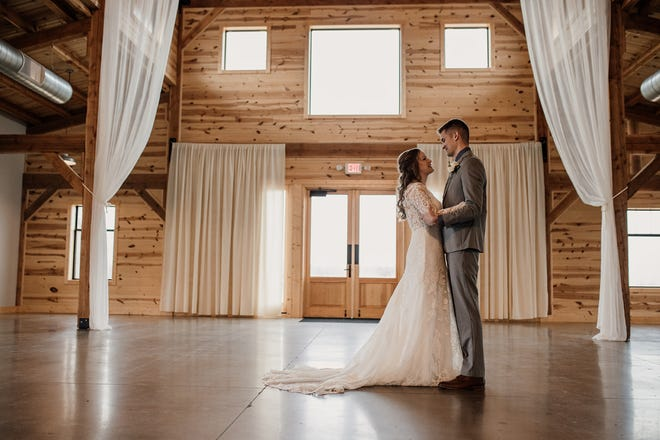 Katie (Odland) and Jay Wieczorek have their first look inside Meadow Barn on Saturday, March 28. The two were married with only Katie's mother and sister as witnesses.