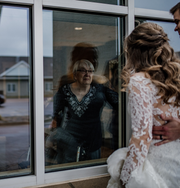 Katie (Odland) and Jay Wieczorek stand outside Trail Ridge Senior Living Community on Saturday, March 28. Katie's grandmother was quarantined and couldn't attend their wedding, so they visited her outside the facility.