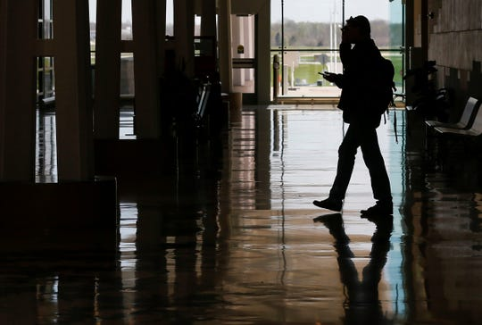 A lone traveler makes his way to the TSA checkpoint at the Springfield-Branson National Airport on Thursday, April 2, 2020. The airport has seen a massive decrease in travel since the outbreak of the coronavirus.