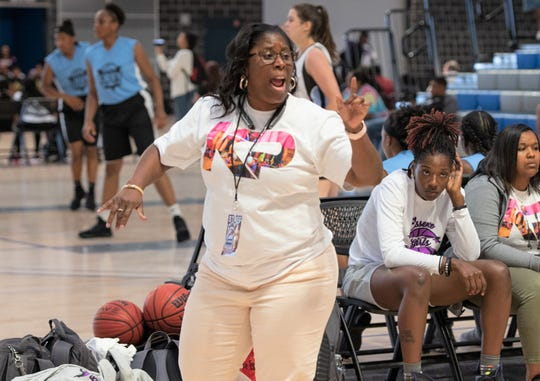 Essence AAU girls basketball coach Kimberly Davis Powell gives out instructions during a game.