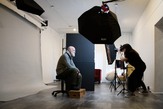 Photographer Kira Derryberry shoots a portrait. When her business slowed because of the coronavirus, Derryberry created the Stay at Home Photography Series.