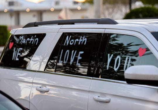 Sarah Colon displays a message on her SUV in support of the staff at Cleveland Clinic Martin North Hospital. She and her two children, and her neighbor, greeted the hospital staff during their shift change Wednesday, April 1, 2020, in Stuart.