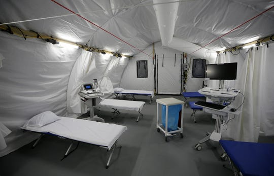 Each tent has 10 beds and a high-tech air circulation system in the parking lot of University Medical Center of El Paso.