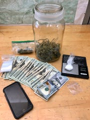 Marijuana, cocaine, cash and other paraphernalia were confiscated Sunday in Moorpark after Ventura County Sheriff's deputies responded to a report of a suspicious vehicle.