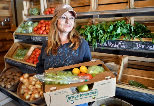 Lori Staas, owner of Jersey Girl Farm Market on Mays Landing Road in Vineland, offers bundle boxes of fresh produce on Thursday, April 2, 2020.