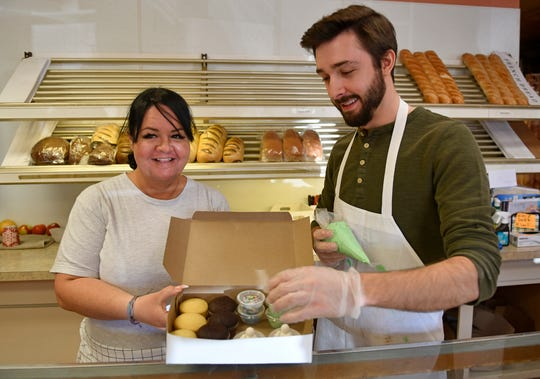 Crust N' Krumbs Bakery in Vineland offers a do-it-yourself cupcake decorating kit, pictured here on Thursday, April 2, 2020. Robyn Cantoni-Lopez, left, and Matt Hallquist show off what is included in the kit.