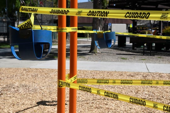 Caution tape blocks off the playground at Whitendale Park on Thursday, April 2, 2020. City of Visalia playgrounds basketball courts, picnic areas and arbors, as well as Provident Skate Park, are closed until further notice in response to the COVID-19 pandemic.