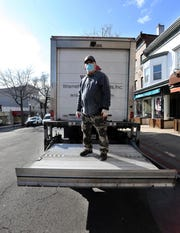 Hector Duran, an employee of Wismettac Asian Foods, Inc. stands on the the ramp of his truck after delivering foods to My Tokyo Restaurant in Tarrytown April 1, 2020. Duran said that deliveries to restaurants have slowed since the start of the coronavirus epidemic, but business to grocery stores and supermarkets have been as busy as usual.
