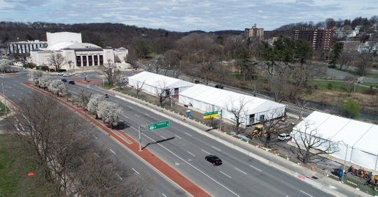 Large white tents are being erected in the parking lot across the street from the Westchester County Center in White Plains on Thursday, April 2, 2020.