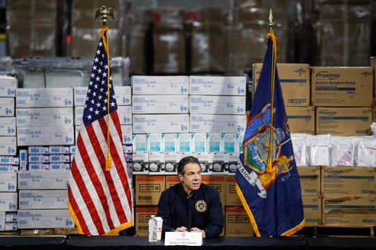 FILE - In this Tuesday, March 24, 2020 file photo, Gov. Andrew Cuomo speaks during a news conference against a backdrop of medical supplies at the Jacob Javits Center that will house a temporary hospital in response to the COVID-19 outbreak in New York.