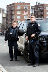 The police officer Kayla Maher from Yonkers and the police officer John Zappia are pictured with their radio-controlled car outside the 3rd district in Yonkers on April 2, 2020. First responders respond to serious medical calls, but others are treated by Empress Ambulance and the Yonkers Fire Department. Maher was the officer who was shot in the face during a suspicious vehicle call in September 2017.