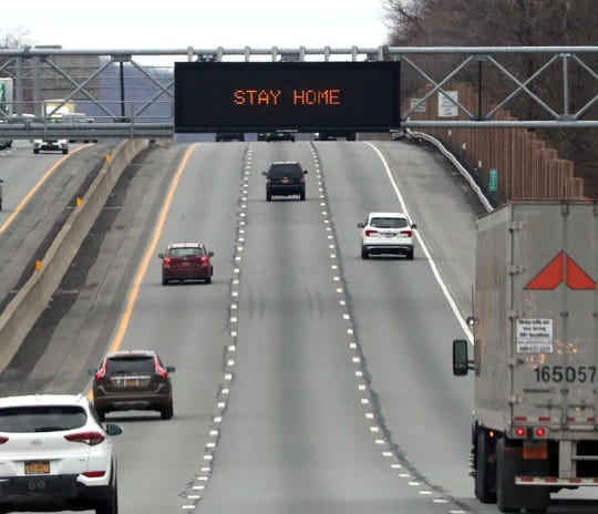 Message board sign over the New York State Thruway in Spring Valley tells people to stay home to avoid getting the COVID-19 coronavirus March 19, 2020.