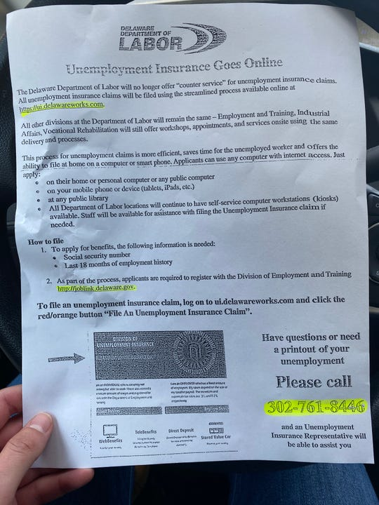 State workers at the Department of Labor's Wilmington office handed out flyers encouraging residents to call a representative if they have questions about their unemployment insurance claim.