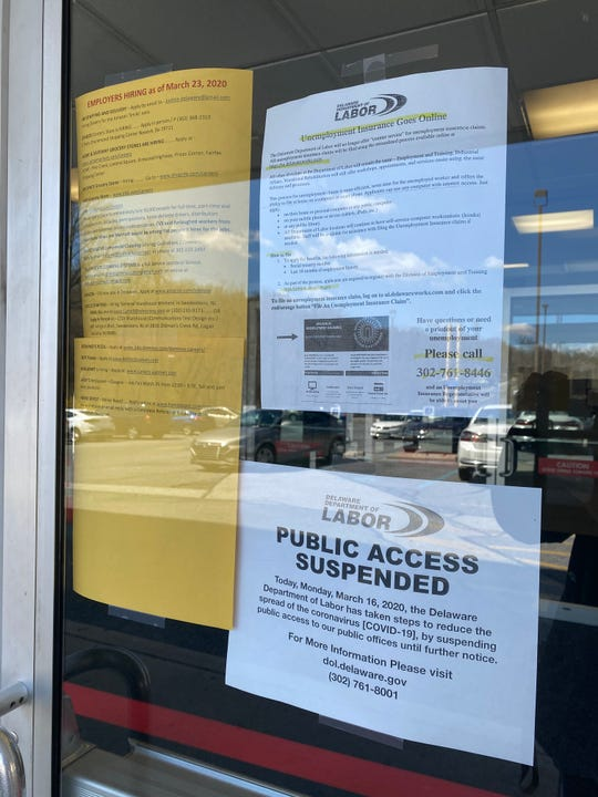 Flyers taped on the glass doors of the Department of Labor's Wilmington office offers job opportunities and asks residents to seek services online instead of in-person during the coronavirus pandemic.