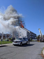 Dover-area firefighters battle a blaze at the Bay Tree Apartments on Thursday.