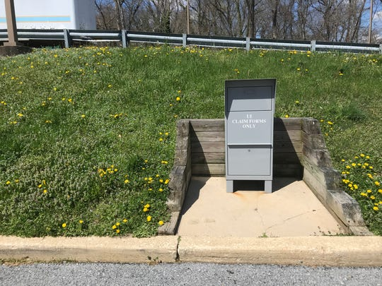 A gray mailbox for unemployment insurance claims stands outside the Delaware Department of Labor's Wilmington office building on Thursday, April 2.
