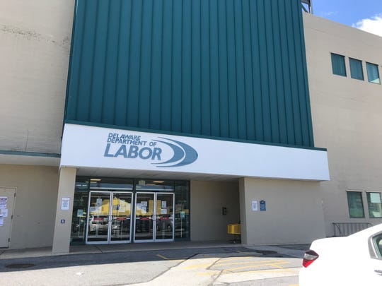 Several informational flyers were posted on the glass doors of the Delaware Department of Labor's Wilmington office building on Thursday, April 2.