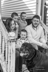 "The Arendt family poses for a photo on their porch as part of the ""Front Porch Project,"" which aims to document families during a time they've been asked to stay home to prevent the spread of COVID-19."