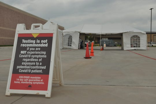 The United Regional Physician Group drive-through collection tent seen Thursday, April 2, has been in place for one week. Patients must have an order from a medical provider in order to use the facility.  A sign says testing is not recommended for patients without symptoms.