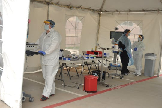 The United Regional Physician Group drive-through collection tent seen Thursday, April 2, has been in place for one week. Patients must have an order from a medical provider in order to use the facility.