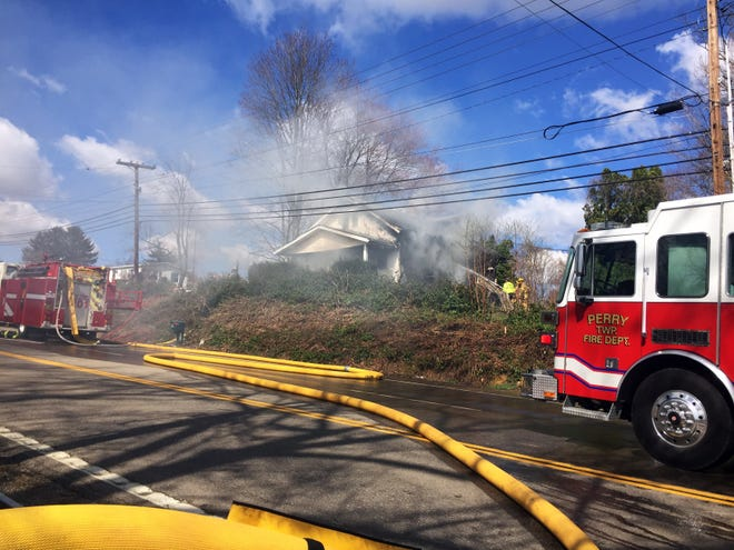 Firefighters from multiple departments are fighting a fire near the Zanesville airport on Thursday.