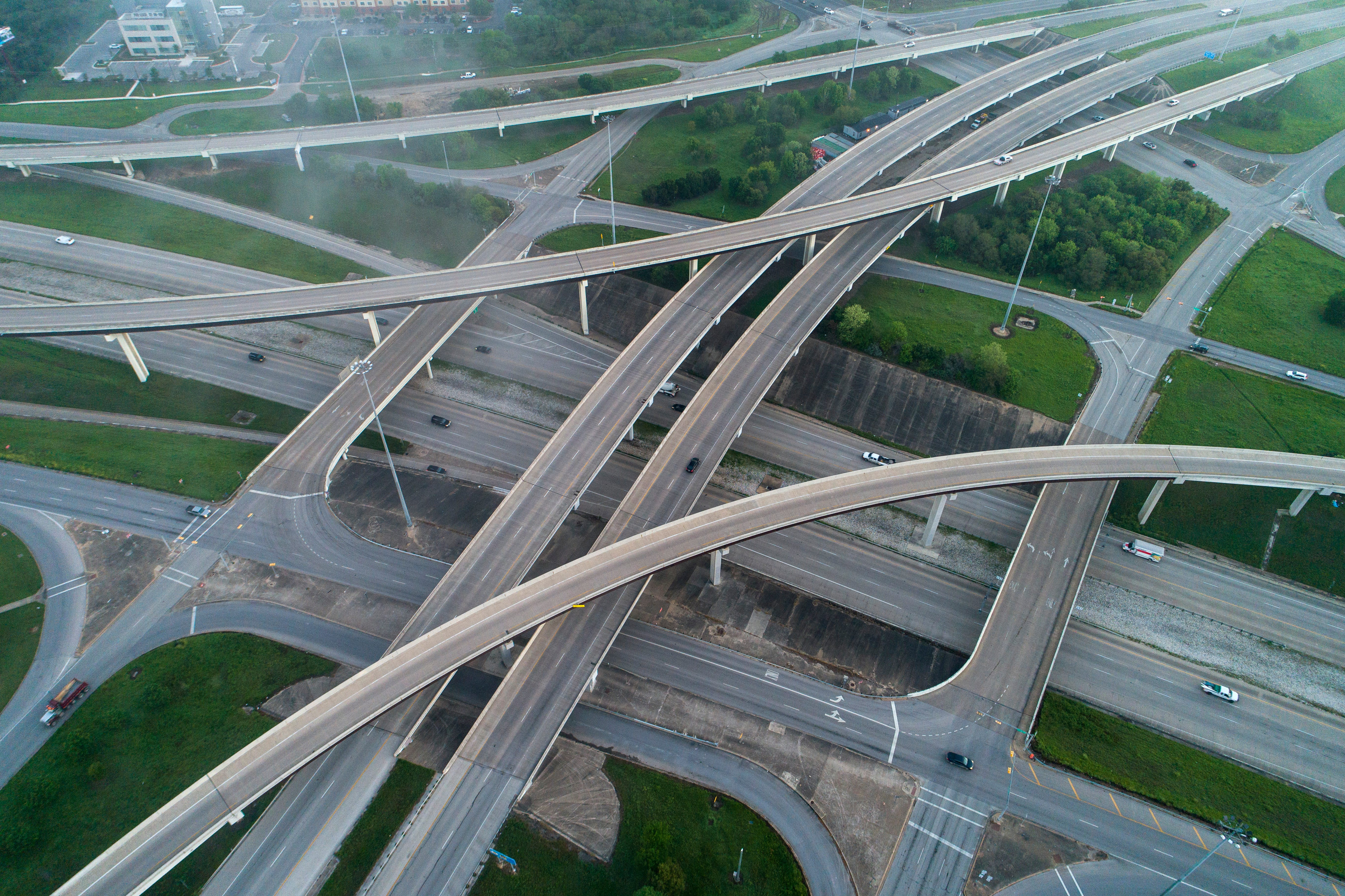 Shelter-in-place orders left neighborhoods, city streets and major thoroughfares eerily empty. On March 25, light traffic flows on the normally busy MoPac Boulevard and U.S. 290 in southwest Austin, Texas.