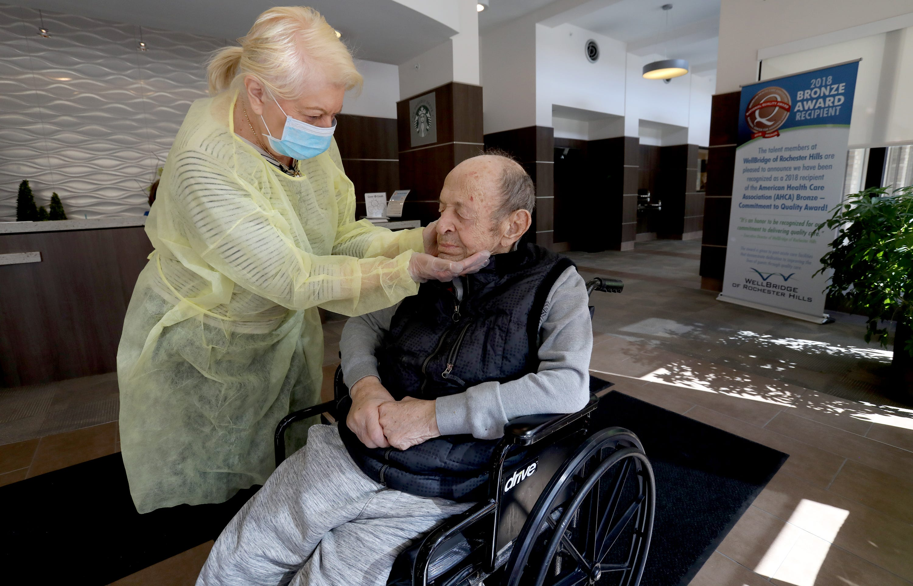 Michigan woman briefly visits husband in a nursing home.