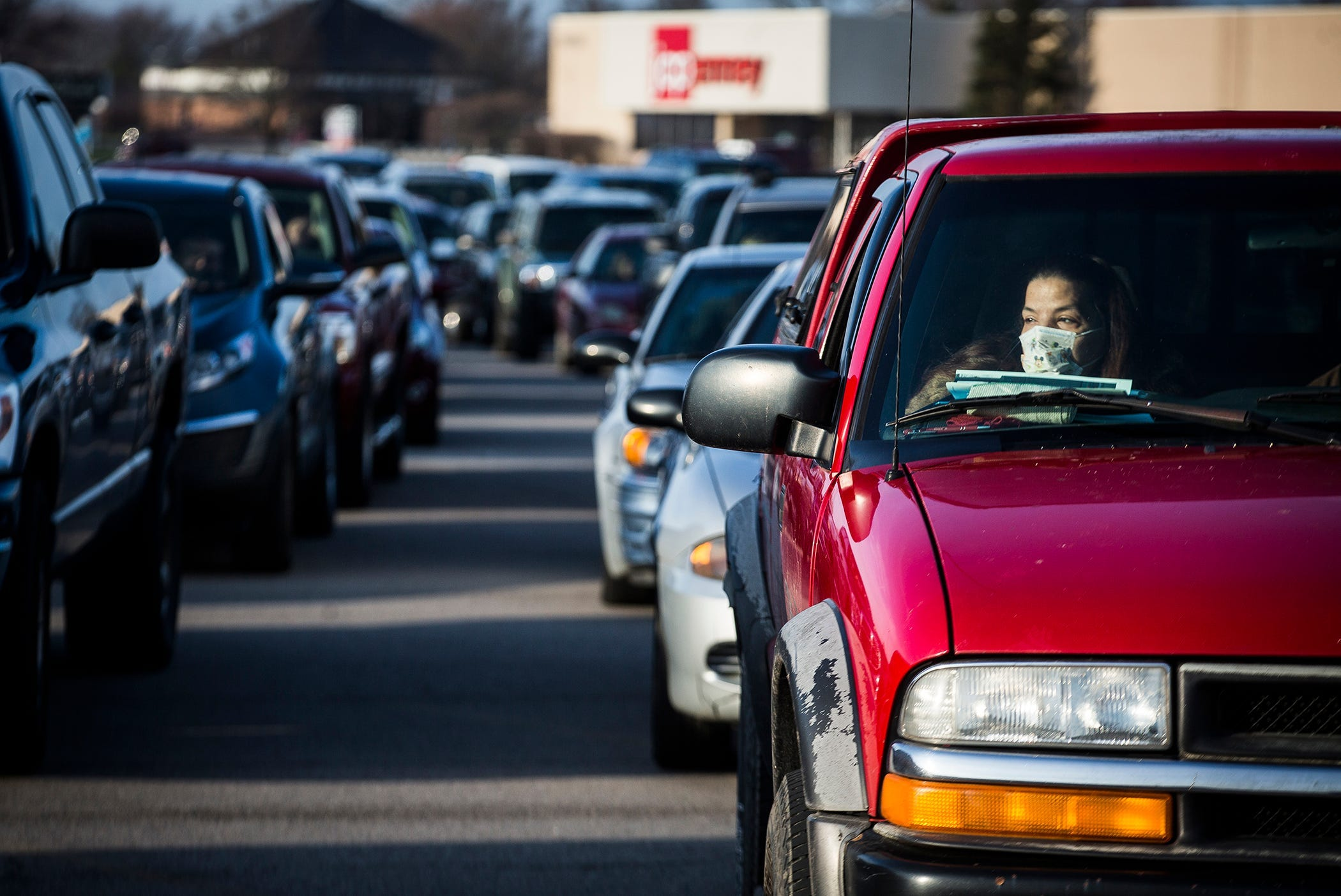 More than 400 cars, many with multiple occupants, were parked outside of the closed Muncie Mall for a Second Harvest Tailgate that gave away food to families in need in Muncie, Ind. on March 27, 2020. The tailgate is one of several Second Harvest is holding to combat hunger during the pandemic.