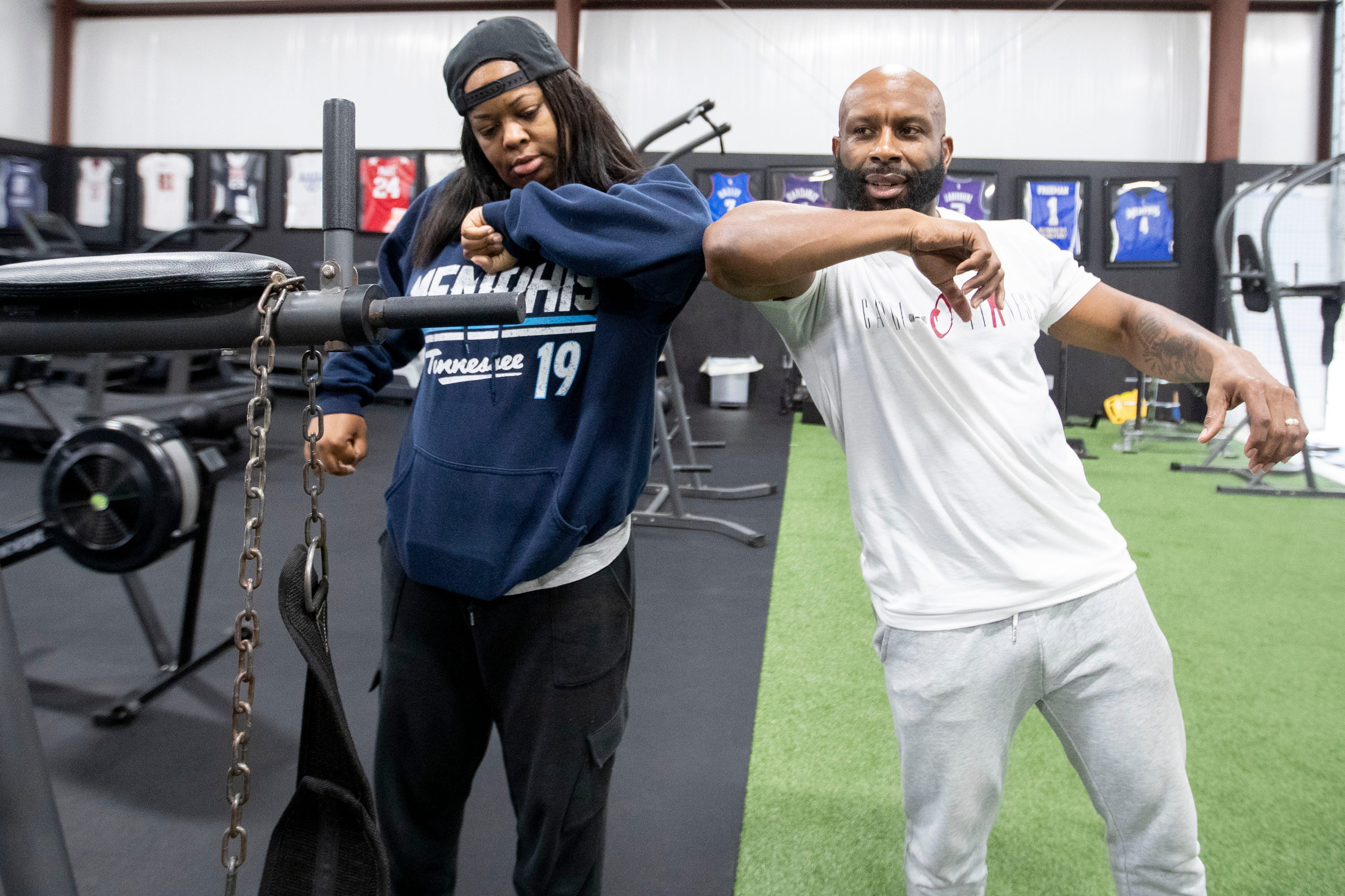 Even the way we say hello has changed. Personal trainer Odie Tolbert, right, elbow-bumps Annika Adams after a workout at Shabazz Fitness in Cordova, Tenn., on March 18.
