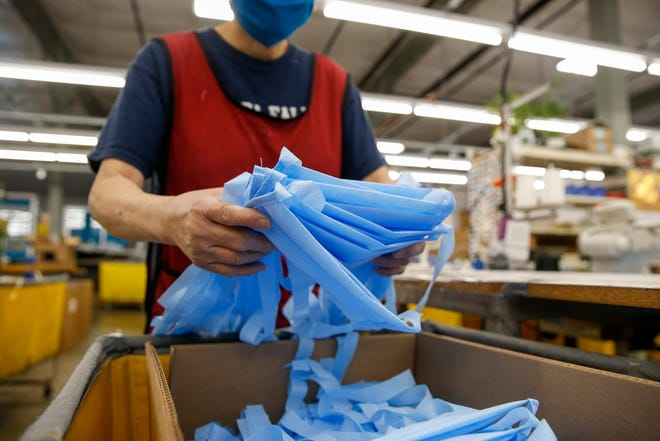 Tom Bihn factory that shifted its production from travel bags to face masks during the COVID-19 outbreak.