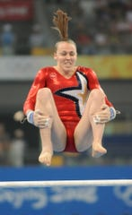 USA gymnast Chellsie Memmel on the uneven bars at the 2012 Beijing Olympics.
