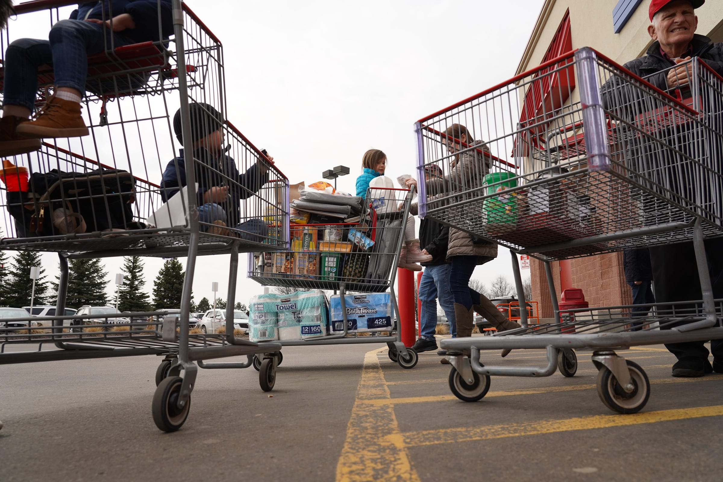 People grab supplies while shopping at Costco in Auburn Hills, Michigan on Wednesday, March 11, 2020.