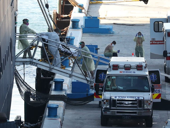 A patient is taken off the the Zaandam cruise ship after it arrived at Port Everglades on April 2, 2020 in Fort Lauderdale, Fla. The Holland America cruise ship had been at sea for the past 19 days after South American ports denied their entry due to the coronavirus outbreak. Reports indicated that two of four people that died aboard the Zaandam had  tested positive for COVID-19.