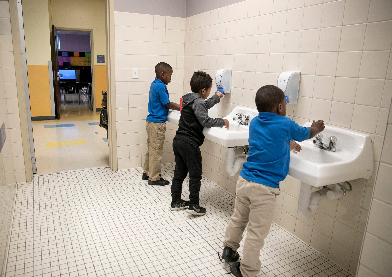 Boys at the IDEA Rundberg charter school in Austin, Texas, wash their hands on April 1, 2020.