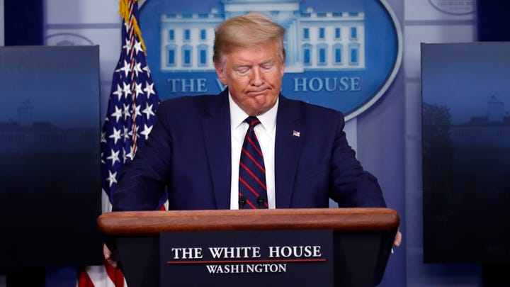 President Donald Trump pauses as he speaks about the coronavirus in the James Brady Press Briefing Room of the White House, Thursday, April 2, 2020, in Washington. (AP Photo/Alex Brandon)