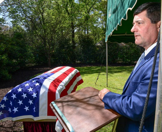 Doug McDougald checks on the appearance of an outdoor military funeral with honors the day before holding the service in the courtyard at McDougald Funeral Home in Anderson.