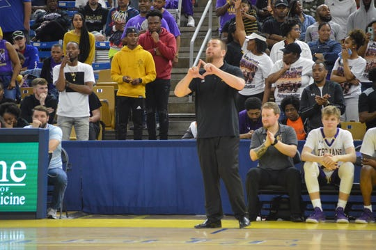 Alexandria Senior High coach Lance Brasher (center) calls out a play during the Class 5A semifinals against Hahnville. Brasher is the 2020 All-Cenla boys basketball Coach of the Year.