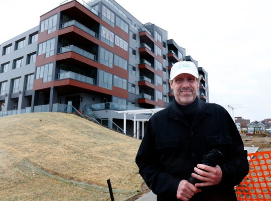 """Realtor Patrick """"Ted"""" Hanley stands Friday, April 3, 2020, outside 365 Ocean - Luxury Oceanfront Residences in Long Branch. Hanley  he is the Builder Representative for the project."""