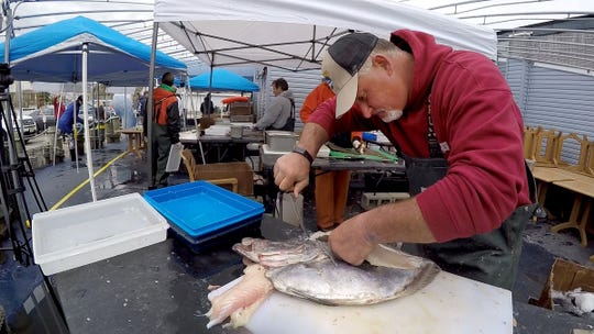 Gambler captain Todd Burger filets a John Dory during the outdoor market at Shore Fresh Seafood Market in Point Pleasant Beach Friday, April 3, 2020.