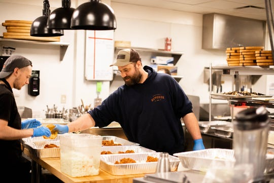Cultura chef Eric Morris dishing out meals.