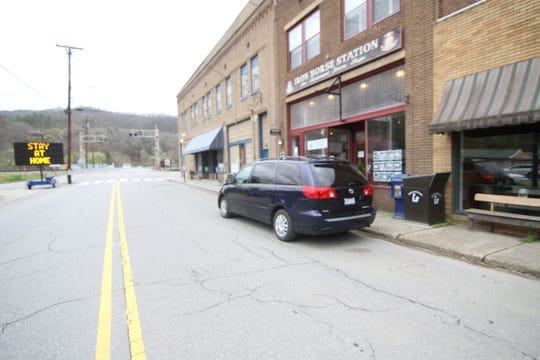With county and state stay at home orders in place, Bridge Street in Hot Springs was barren the afternoon of April 1, 2020. Cool, wet weather may have also played a part; two days earlier, town officials in Hot Springs shared reports of a number of hikers on this stretch of the Appalachian Trail.