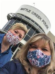 Jennifer Rogers (left) and Jennifer Ellison wear fabric masks outside the Battle Creek Police Department.