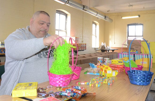 Alphonse Bifulco, who began his New Leaf Project several years ago, prepares Easter baskets in 2018. He is seeking some food and candy donations this year before distributing food and baskets to Battle Creek families on Saturday.  Trace Christenson/The Enquirer