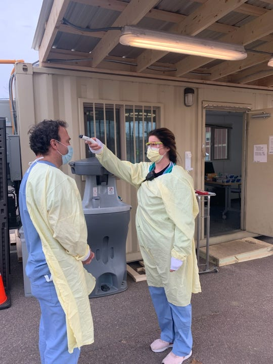 Emergency Department staff are screened for COVID-19 symptoms before reporting for work at the University of Vermont Medical Center in Burlington on Saturday, March 28, 2020.
