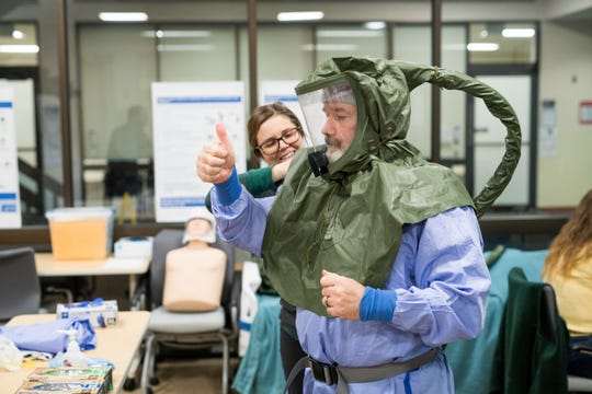 Emergency Department staff don personal protective equipment to guard against COVID-19 at Central Vermont Medical Center in Berilin on Friday, March 27, 2020.