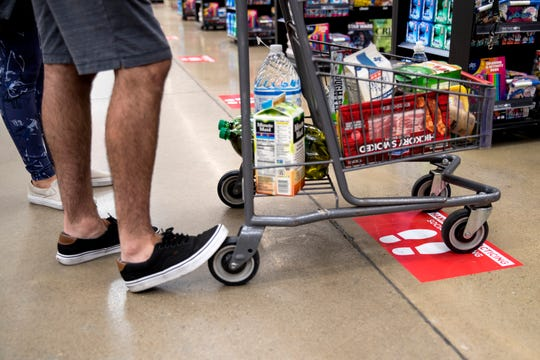 H-E-B has put several measures in place to encourage social distancing. Footprints on the floor, as well as signage indicates where shoppers should stop and wait before advancing to check out. All stores in the Corpus Christi area have been updated as of Friday, April 3, 2020.