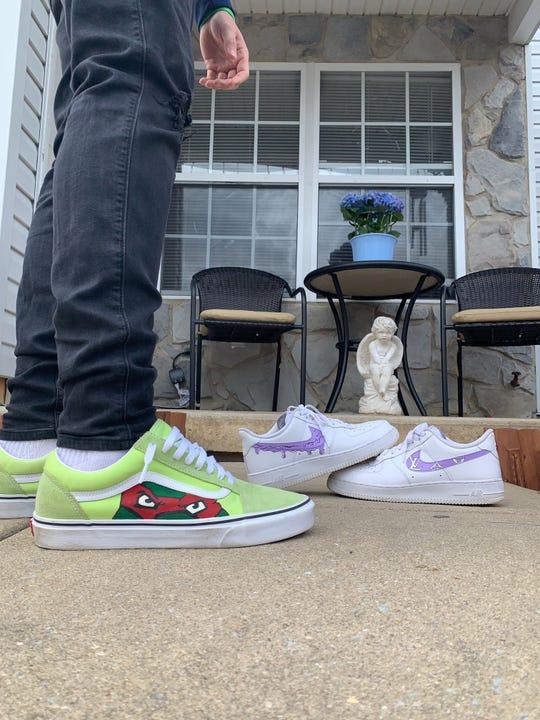 Timber Creek senior Jon Martinez shoes off some of his shoe designs.