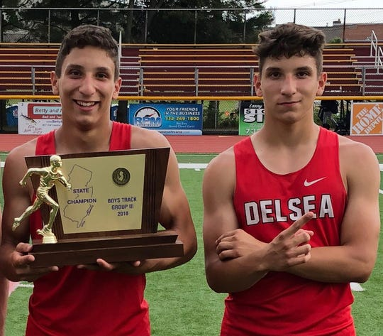 Delsea seniors and twins Nico, left, and Marco Morales pose with the championship trophy after the Crusader boys track and field program won Group 3 states in 2018.