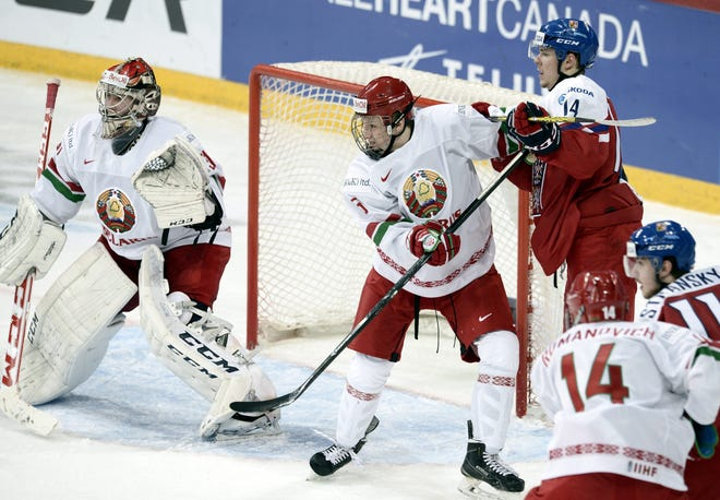 Ilya Sushko, center, seen here in the 2016 World Junior Championship playing for Belarus, was in the only active hockey league still running. His team lost in the Belarus final Friday.