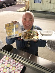 An unidentified Cooper University Hospital worker holds a nachos from one of the food trucks serving hospital employees on weekends and on the overnight shift during the coronavirus pandemic.